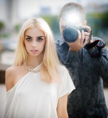 The photographer and his model. Selective soft focus.