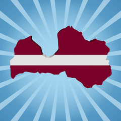 Latvia map flag on blue sunburst illustration