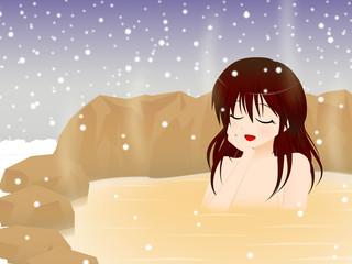 温泉に浸かる女性 冬