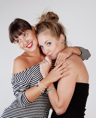 Two Young Female Friends Embracing