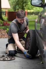 Man changing car wheel