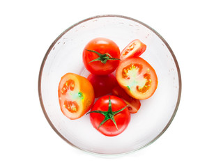 tomato in bowl isolated on white