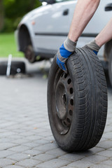Rolling a spare of wheel