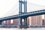 Manhattan Bridge and skyline view from Brooklyn at sunset