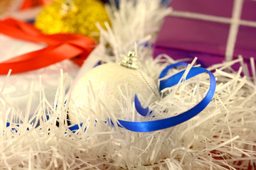 Christmas background with red and blue ribbon and white balls