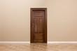 Wooden door in the empty room with copy space