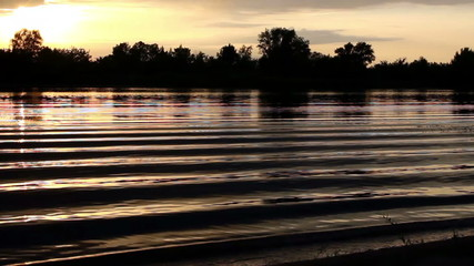 Sunset on the river (lake) with waves