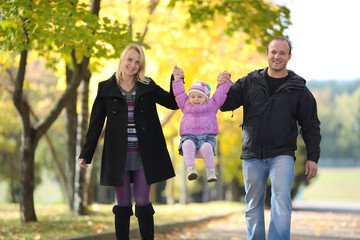 The happy family walks on autumn park