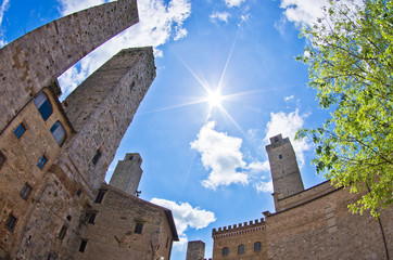Fisheye view of San Gimignano towers on central square, Tuscany