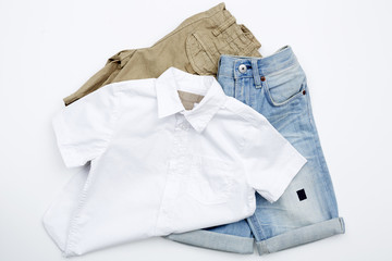 Shorts and shirt against white background.