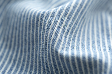 Close up of striped denim material.