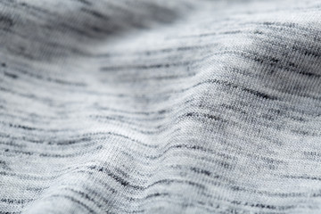 Close up pattern of grey t-shirt .