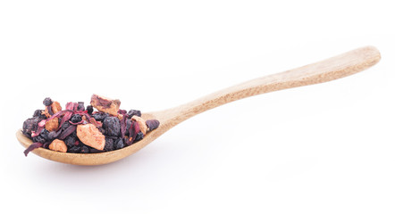 Dry fruits and wild berries in the wooden spoon