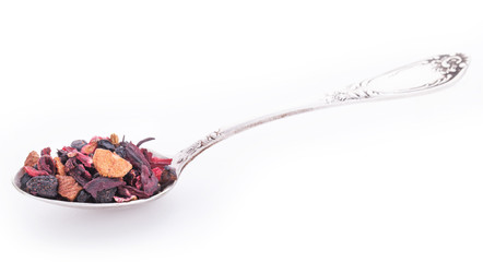 Dry fruits and wild berries in the silver spoon