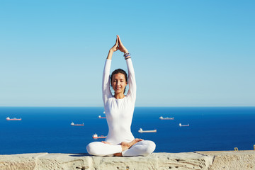 Happy attractive woman engage yoga at sunny day in summer