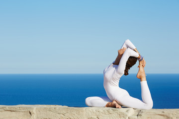 Yoga at sunny day performing by beautiful healthy woman