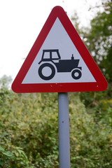 Tractor ahead sign and signpost