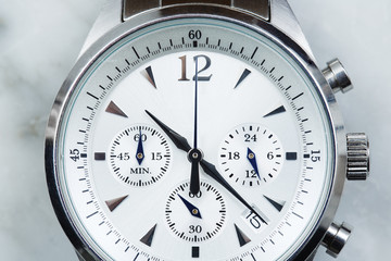Luxury men's watch face, close up .