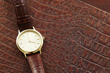 Luxury men's watch on leather, close up.