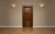 Closed wooden door in the empty room with copy space