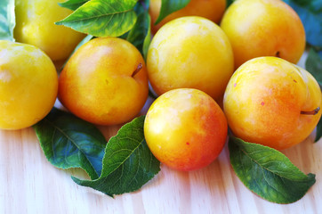 yellow plums on table