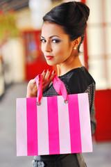 Fashion shopping girl portrait. Beautiful woman with shopping ba