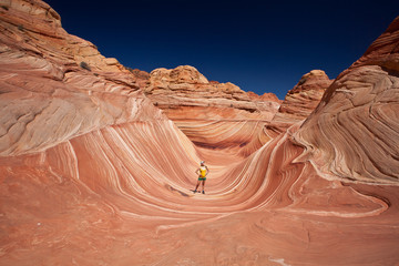 USA - girl in the Coyote buttes recreational park - The wave