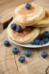 Fritters with fresh blueberries, close-up, vertical shot