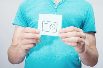 Picture icon camera in hand