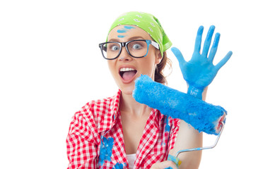 Funny amazed woman with roller ready for wall painting