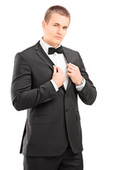 Confident man in a black suit posing