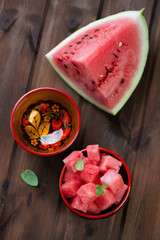 Watermelon cubes in khokhloma wooden bowls, above view