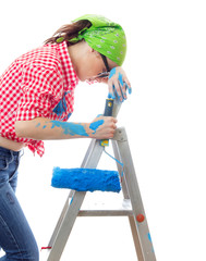 Tired woman with paint roller