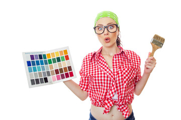 Surprised woman holding paintbrush and color sample