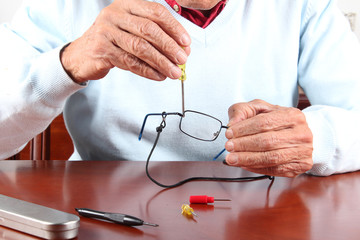 Senior man fixing glasses