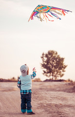 boy playing kite on a wind
