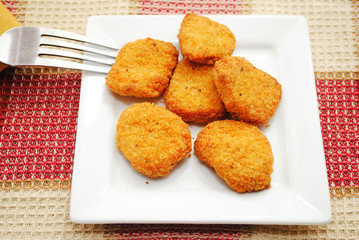 Delicious Chicken or Fish Nuggets Served on a White Plate