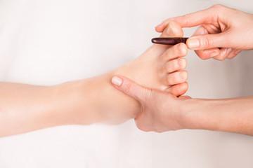 masseur makes thai foot massage