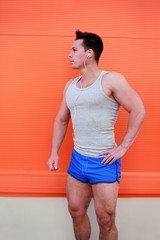 Sportsman posing against colorful wall. Fitness, sport, workout