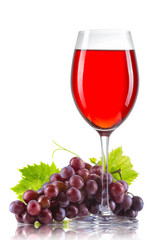 Glass of red wine and a bunch of ripe grapes isolated