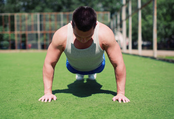 Sportsman push ups outdoors, fitness, workout, sport - concept