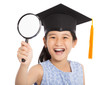 happy school little girl holding magnifier