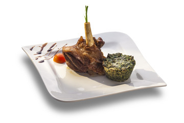 Lamb knuckle with roasted spinach puree
