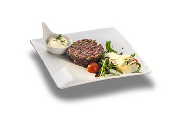 Tasty Steak tartar and rocket salad with cheese ready to serve