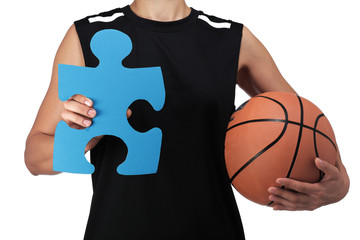 basketball player holding a puzzle piece