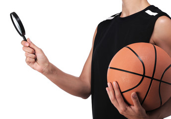 basketball player holding a magnifying glass