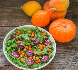salad with roasted pumpkin, beets, arugula and sunflower seeds