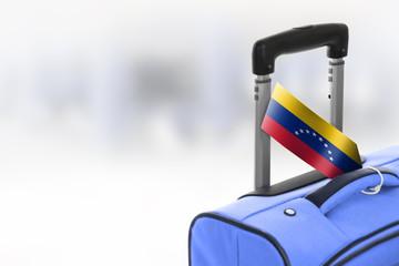 Destination Venezuela. Blue suitcase with flag.