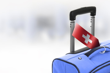 Destination Switzerland. Blue suitcase with flag.