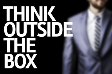 Think Outside The Box written on a board